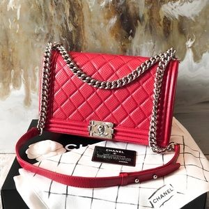 c56f20ced527 CHANEL · Chanel Red Perforated Calf Silver Boy Medium Bag. $5,495 $11,111